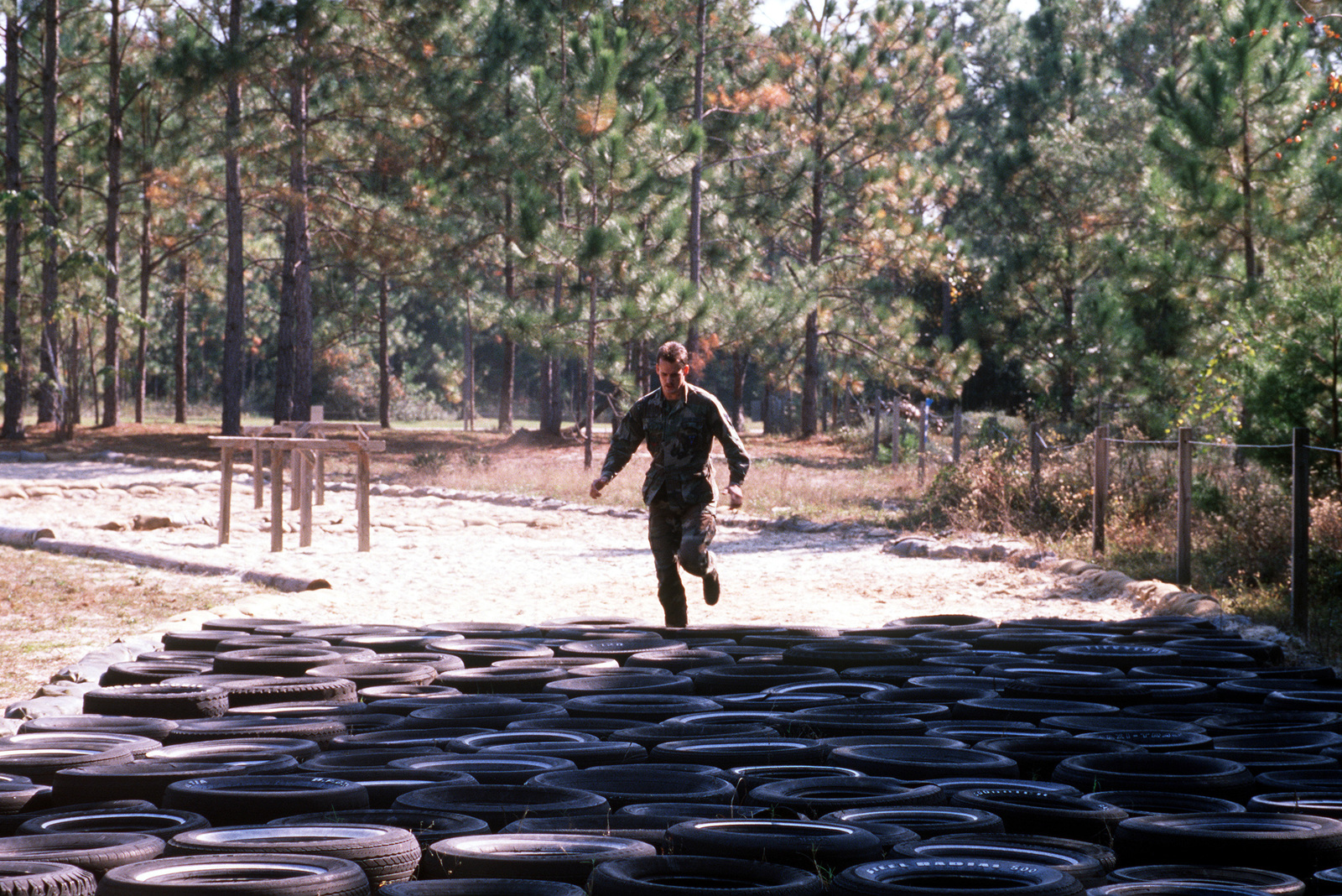 A participant runs through an obstacle course, one of several categories in the seventh annual Tactical Air Command and Control Specialists Competition