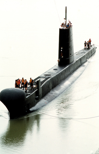 Crewmen stand on the deck of the British patrol submarine HMS OCELOT (S-17) as it passes through the Miraflores Locks during its transit of the Panama Canal