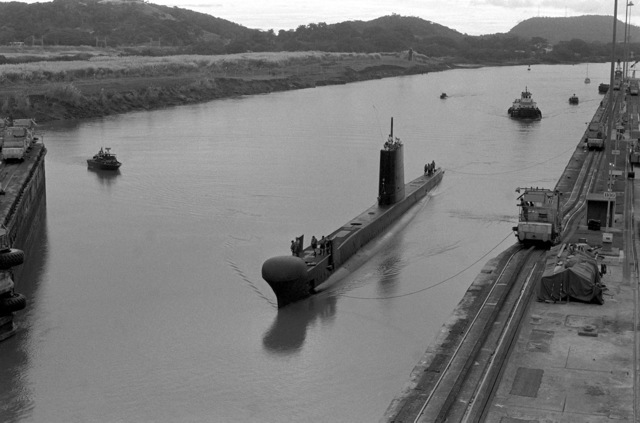 Escorted by a US Navy PBR Mark 2 riverine patrol boat, the British patrol submarine HMS OCELOT (S-17) enters the Miraflores Locks during its transit of the Panama Canal