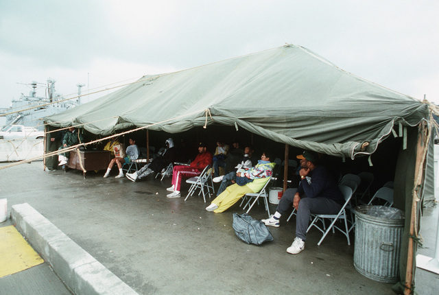 Residents of the San Francisco area who were forced to leave their homes gather under a tent at a U.S. Navy installation for shelter in the aftermath of a major earthquake that devastated the area on October 17