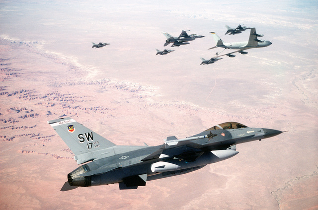 Six F-16C Fighting Falcon aircraft from the 17th Tactical Fighter Squadron fly in formation behind a KC-135 Stratotanker aircraft during the U.S. Central Command Exercise Quick Force. The exercise is designed to increase combat capabilities and provide a realistic combat environment simulating areas such as Southwest Asia, the Middle East and the Horn of Africa. The refueling is taking place at the Utah Test and Training Range