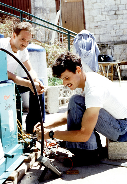 US Navy personnel check a generator during recovery efforts in the aftermath of Hurricane Hugo, which devastated the area on September 19th