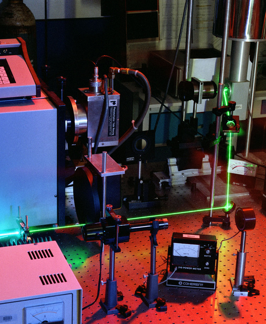 A helium ion laser is used on a test bench in the electronic technology and devices (ET&D) laboratory as part of an ET&D communications research project