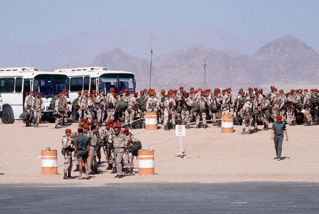 Soldiers from the 1ST Bn., 9th Infantry, 7th Infantry Div., wait for their gear to be checked before boarding buses for the first leg of their trip home. The soldiers and their unit are serving as peacekeepers in the Sinai desert with the Multinational Force and Observers