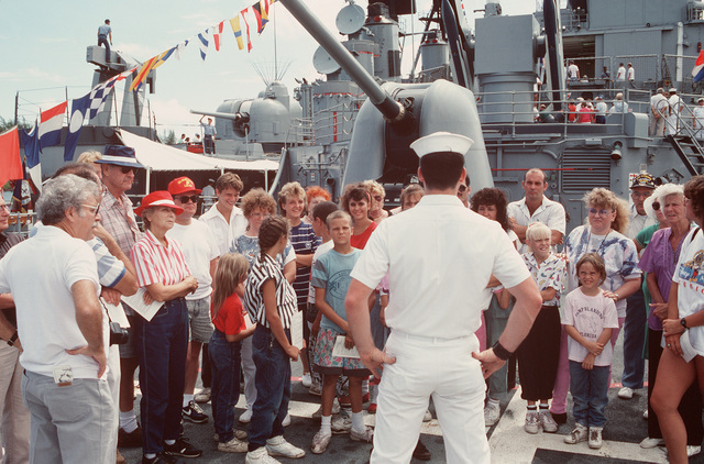 A sailor speaks to guests touring the guided missile destroyer USS SCOTT (DDG 995) during Navy Appreciation Week 1989, which is sponsored by the Port Everglades Authority, the Broward County community and the Navy League of the United States