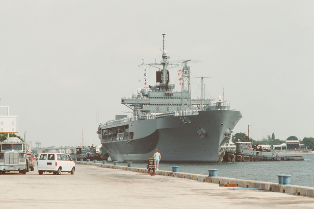 Commercial tugs assist the amphibious command ship USS MOUNT WHITNEY (LCC 20) in maneuvering into its place at the pier as it arrives for Navy Appreciation Week 1989, which is sponsored by the Port Everglades Authority, the Broward County community and the Navy League of the United States
