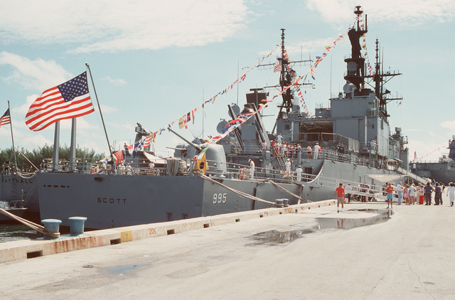 Guests wait on the pier for a tour of the guided missile destroyer USS SCOTT (DDG 995) during Navy Appreciation Week 1989, which is sponsored by the Port Everglades Authority, the Broward County community and th Navy League of the United States. The guided missile destroyer USS TATTNALL (DDG 19) is tied up beside the Scott