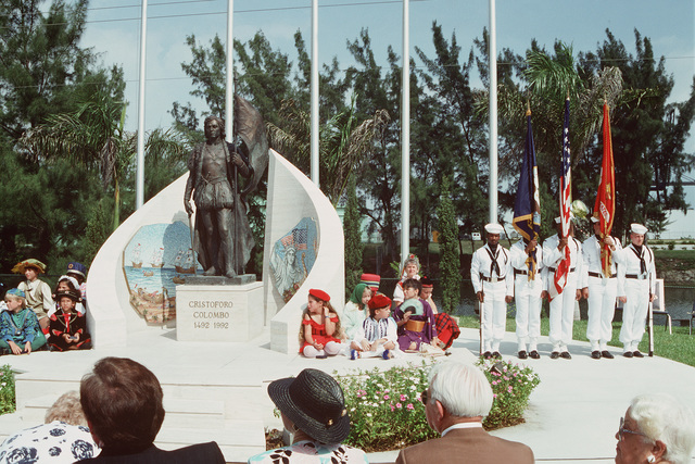 A Navy color guard stands at attention beside a statue of Christopher Columbus that is being dedicated by the local Italian-American Chamber of Commerce. The ceremony is taking place during Navy Appreciation Week 1989, which is sponsored by the Port Everglades Authority, the Broward County community and the Navy League of the United States