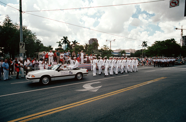 As they pass the reviewing stand during the General Lewis Walt Memorial Parade, crewmen from the nuclear-powered attack submarine USS ALBUQUERQUE (SSN 706) march behind an automobile in which their commanding officer is riding. The parade is among the activites being held during Navy Appreciation Week 1989, which is sponsored by the Port Everglades Authority, the Broward County community and the Navy League of the United States