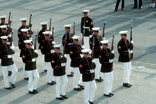 Members of the U.S. Marine Corps Silent Drill Team perform along the parade route during the GEN. Lewis Walt Memorial Parade. The parade is among the activities being held during Navy Appreciation Week 1989, which is sponsored by the Port Everglades Authority, the Broward County community and the Navy League of the United States