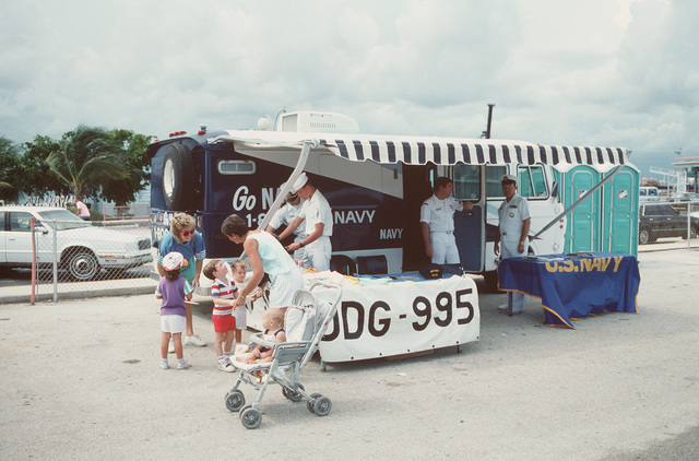 A recruiting van sits parked across from theNavy ships tied up at the pier for Navy Appreciation Week 1989, which is sponsored by the Port Everglades Authority, the Broward County community and th Navy League of the United States