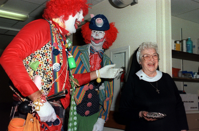 CHIEF Boatswain's Mate Frank Brant and CHIEF Aviation Electronics Technician Bruce Berg masquerade as clowns during a benefit performance at Mercy Hospital. Brant and Berg are crew members aboard the aircraft carrier JOHN F. KENNEDY (CV 67)