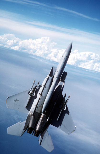 A 33rd Tactical Fighter Wing F-15C Eagle aircraft pulls into a climb during a flight out of Eglin Air Force Base, Fla. The aircraft is carrying two AIM-9 Sidewinder missiles on each wing and four AIM-120 advanced medium-range air-to-air missiles (AMRAAMs) on its fuselage weapons stations