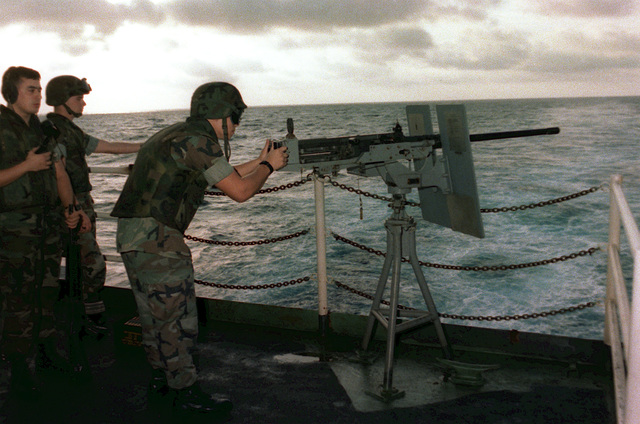 A security force team member fires an M60 .50-caliber machine gun during an exercise aboard the aircraft carrier JOHN F. KENNEDY (CV 67)