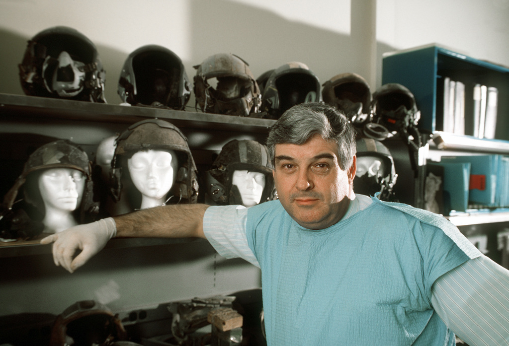 Mike Grost, chief investigator at the Life Support Equipment Investigation Laboratory, pauses beside some of the flight helmets retrieved from the scenes of aircraft crashes. Grost analyzes flight gear, clothing, life support equipment and aircraft parts to determine the cause of plane accidents in the interest of preventing future tragedies