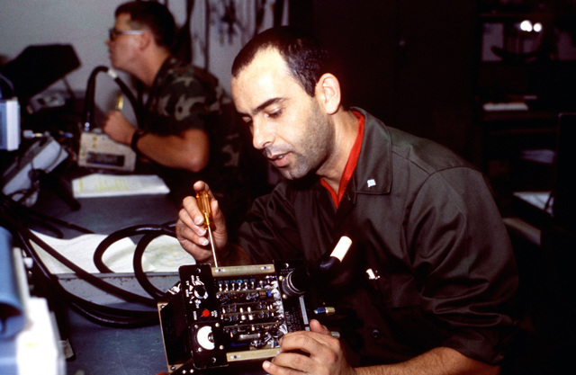 A student from the Greek armed forces reparis an automatic speed trim amplifier from a CH-47C Chinook helicopter while in training at the US Army Signal Center