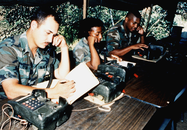 Soldiers use TA-1035/U non-secure digital telephone voice terminals in the field