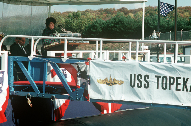 Secretary of Labor Elizabeth Hanford Dole, ship's sponsor for the nuclear-powered attack submarine USS TOPEKA (SSN 754), speaks during the vessel's commissioning ceremony