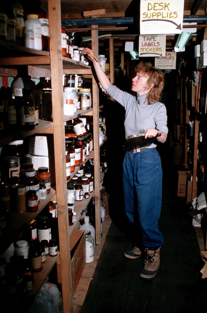 Kristin Larson takes an inventory of supplies for the BioLab Facilities at McMurdo Station