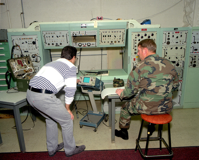 James Rollins, left, and SGT. 1ST Class Wayne Rehkamp run a diagnostic program on an AN/VPS-2 radar receiving transmitter, which is used with the Vulcan Air Defense System