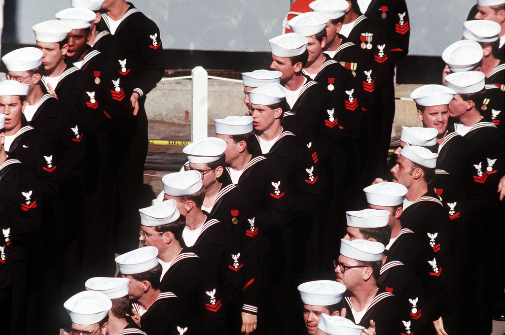 Sailors stand in formation during the commissioning ceremony of the nuclear-powered aircraft carrier USS ABRAHAM LINCOLN (CVN-72)