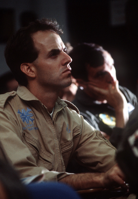 A civilian pilot from Flight International Corporation (FIC) sits in on a post-mission conference during exercise COPE THUNDER 89-5. Videotape footage of Air Force aircraft in action during the exercise is being shot from an FIC aircraft