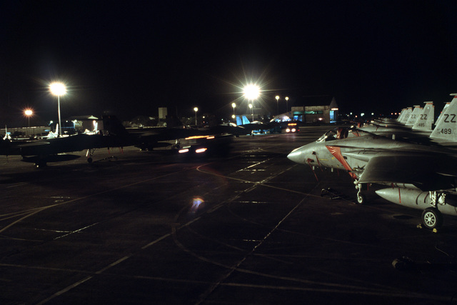 Work lights illuminate several F-15C Eagle aircraft from 18th Tactical Fighter Wing as maintenance crews work into the night during exercise COPE THUNDER 89-5
