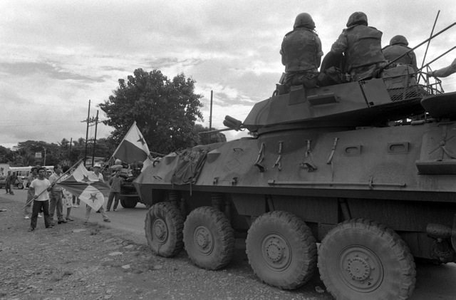 During Operation ROUGH RIDER, a route reconnaissance patrol, a column of LAV25 light armored vehicles from Company D, 2nd Light Armored Infantry Battalion, encounters a crowd of Panamanians blocking the road as they protest the US presence in Panama