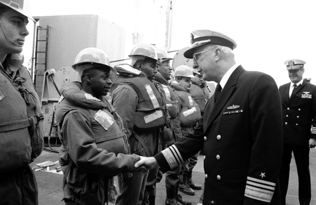 Vice Admiral John W. Nyquist, Assistant CHIEF of Naval Operations, Surface Warfare, greet sailors aboard the replenishment oiler USS SAVANNAH (AOR 4) as he visits aboard the ship