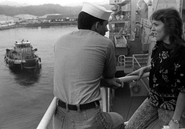 SEAMAN Apprentice Allen Sanders and his wife Michelle talk as they wait to get underway aboard the combat stores ship USNS SPICA (T-AFS-9) for a dependent's day cruise in the South China Sea. One hundred and fifty dependents and guests spent the day on the ship