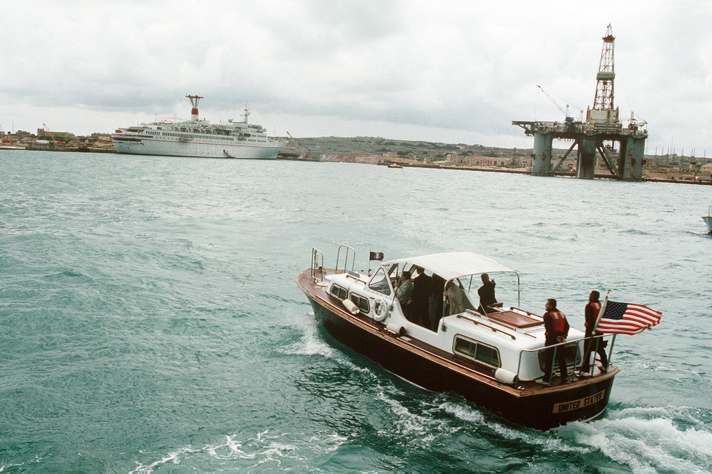 A 33-foot personnel boat carries President George Bush across the bay toward the Soviet passenger liner MAXSIM GORKIY for a meeting with Soviet Chairman Mikhail Gorbachev. The two leaders had intended to hold their summit talks aboard warships from their respective nations, but poor weather forced the meeting site to be shifted to the Soviet passenger liner MAXSIM GORKIY, which is tied up to a pier ashore