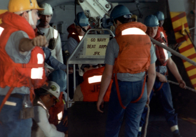 Boatswain's mates aboard the aircraft carrier USS JOHN F. KENNEDY (CV 67) prepare a manila highline rig to transfer an officer to the ammunition ship USS SANTA BARBARA (AE 28) during an underway replenishment