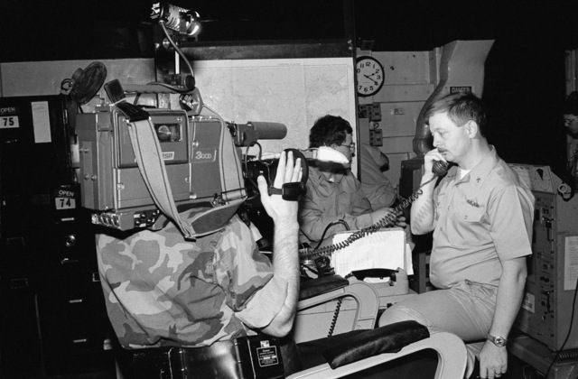 A cameraman films personnel aboard the frigate USS CAPODANNO (FF 1093) participating in radio interoperability tests between US and Soviet naval forces. The communications exercise is being conducted under guidelines in the Dangerous Military Activities Agreement