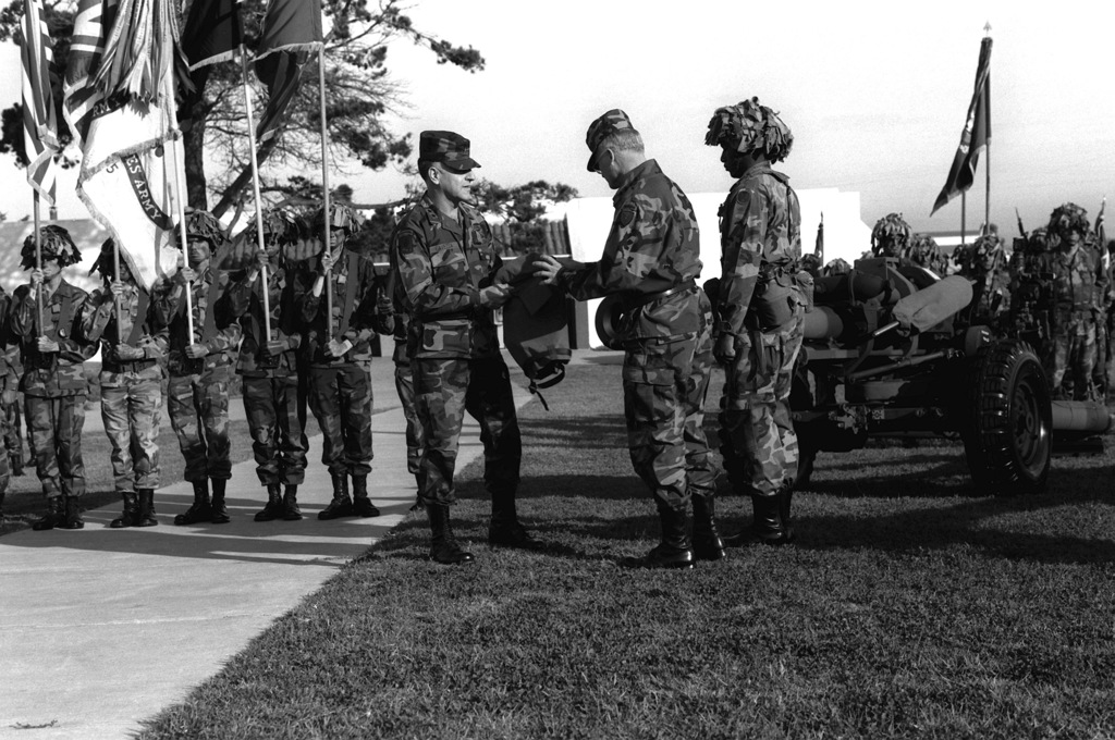 GEN William G.T. Tuttle, commander, Army Material Command, right, and MGEN Carmen J. Cavezza officiate at a ceremony for the M-119 105mm howitzer