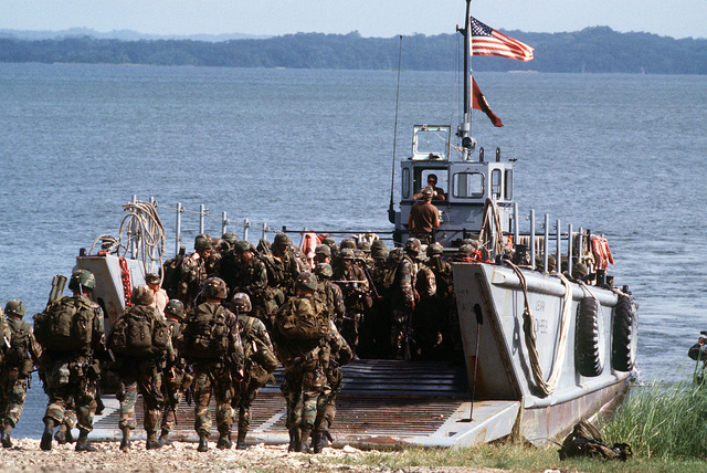 Soldiers of the 82nd Airborne Division board an Army LCM-8 mechanized landing craft at the shore of Gatun Lake at the beginning of Operation Strike Hold, an Army contingency exercise