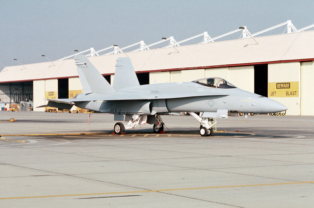 The first F/A-18C(N) Hornet aircraft to be delivered to Strike Fighter Squadron 147 (VFA-147) stands on the flight line following its arrival at the air station from McDonnell-Douglas corporate facilities in St. Louis. The squadron is making the transition from A-7E Corsair II aircraft to the more technologically advanced Hornet