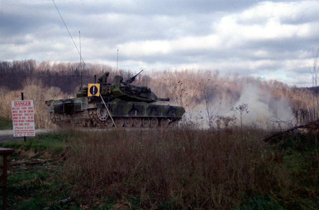 A US Army M-1 Abrams main battle tank test fires a 105 mm round developed by the Army with the assistance of Naval Ordnance Station, Louisville, Kentucky