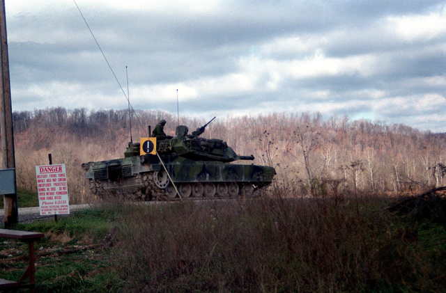 A US Army M-1 Abrams main battle tank waits at a firing point prior to test firing 105 mm ammunition developed by the Army with the assistance of Naval Ordnance Station, Louisville, Kentucky