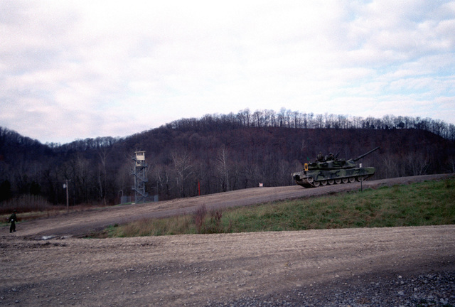 A US Army M1 M-1 Abrams main battle tank moves towards the firing line. The tank will be test firing 105 mm ammunition developed by the Army with the assistance of Naval Ordnance Station, Louisville, Kentucky