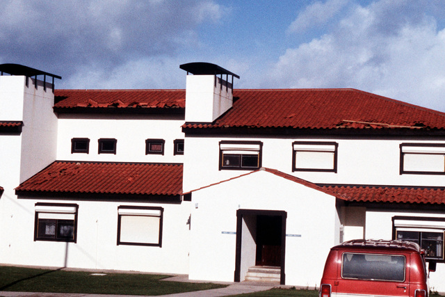 Damaged roof shingles display the force of a windstorm that hit Terceira Island with winds of up to 164 miles per hour