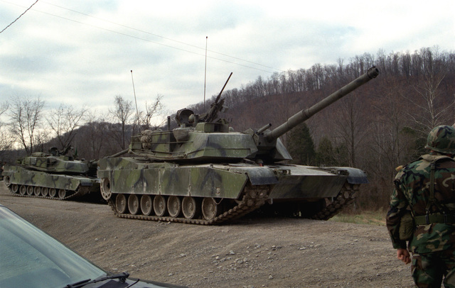 Two US Army M1 M-1 Abrams main battle tanks move up to the firing line. The tanks will be test firing 105 mm ammunition developed by the Army with the assistance of Naval Ordnance Station, Louisville, Kentucky