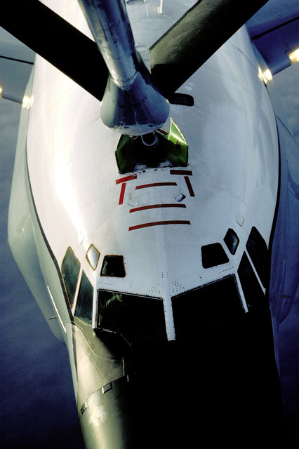 A partial view from a KC-135R Stratotanker aircraft boom operator's station of an RC-135 Stratoliner aircraft of the 306th Strategic Wing being refueled in flight