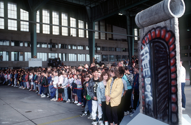 A crowd gathers by a section of the Berlin Wall following Germany's reunification