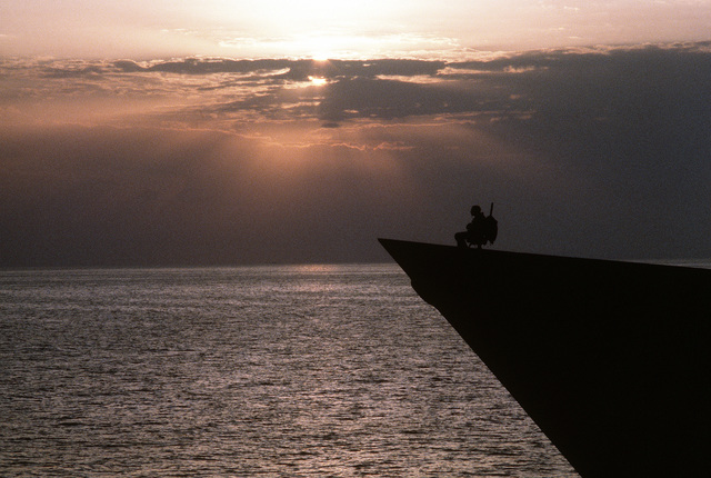 A sailor stands watch at the bow of a ship on patrol in the gulf during Operation Desert Shield/Operation Desert Storm