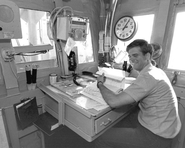 A signalman studies in the signalman's cage aboard the destroyer USS PETERSON (DD-969) during FLEET EX 1-90