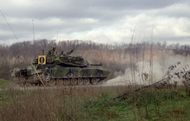 A US Army M-1 Abrams main battle tank test fires a 105mmround developed by the Army with the assistance of Naval Ordnance Station, Louisville, Ky