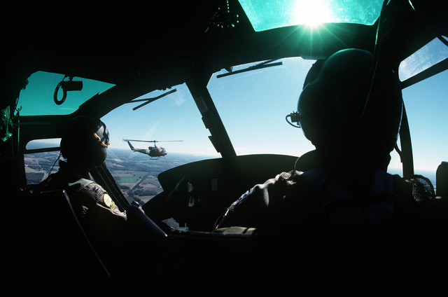 Accompanied by an instructor, an undergraduate helicopter training student pilots his UH-1U Iroquois helicopter during a training flight near Fort Rucker. As the center of Army aviation, Fort Rucker produces hundreds of aviation course graduates each year. While the majority of these students are soldiers, approximately 50 are Air Force personnel