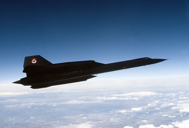 Air to air view right side view of a 9th Strategic Reconnaissance Wing's SR-71 Blackbird reconnaissance aircraft, on a mission out of Beale Air Force Base, California. Exact Date Shot Unknown
