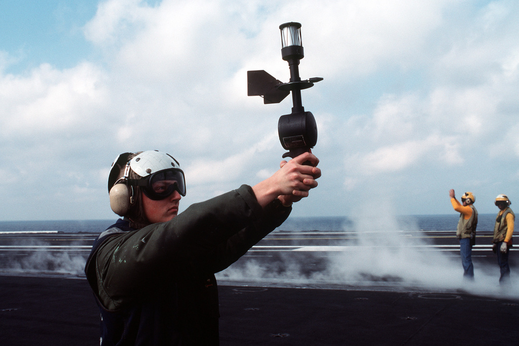 An aerographer's mate uses an AN/PMQ-3 anemometer to measure wind speed and direction on the nuclear-powered aircraft carrier USS DWIGHT D. EISENHOWER (CVN-69) during Fleet Ex '90