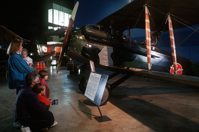 Museum visitors Bob and Marjo Gunnison and their children study a World War I Spad XVI aircraft exhibit at the Air Force Museum, the world's largest repository of aviation memorabilia